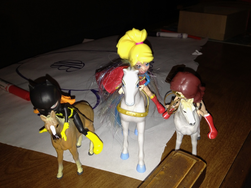 Batgirl, Supergirl, and Wonder Woman on horseback to save the day!